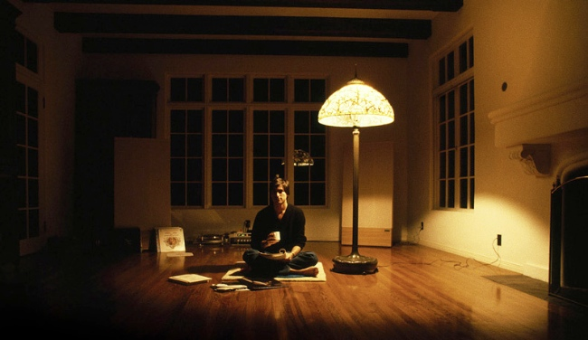 Steve Jobs, CEO of Apple, having a Zen moment at home in 1982
